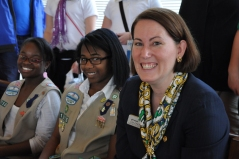 GSNCCP CEO, Lisa Jones, sitting with fellow Girl Scouts as the proclamation is read.