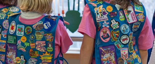 Girl Scouts can earn Badges (front of the uniform) or Patches (back of the uniform).